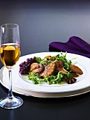 Fried goose liver with caramelised apples & salad, glass of ice wine