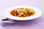 Squid soup with celery and capers