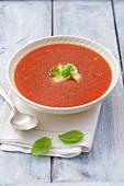 Tomato soup with mozzarella and basil