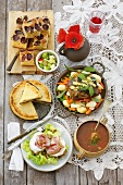 Tomato soup, crostini, pork neck, potato cake and plum cake