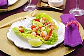 Prawn cocktail with avocado on lettuce leaves