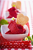 Strawberry sorbet with heart-shaped wafer