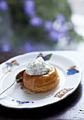 Baba au rhum (yeast cake soaked in rum) with cream