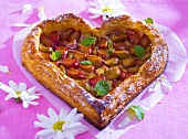 Heart-shaped rhubarb puff pastry tart