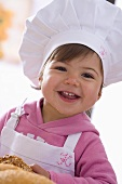Little girl in chef's hat