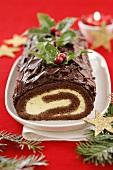 Chocolate sponge roll with orange cream filling (Christmas)