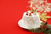 Small Christmas cake with one candle