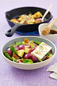 Fried vegetables (pumpkin and onions) with spinach and feta