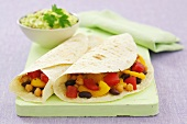 Beans, peppers and chick-peas in wheat tortillas