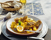 Chicken with potatoes and egg in saffron sauce, Mexico