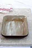 Buttered baking dish