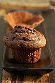 Chocolate muffin and empty paper case