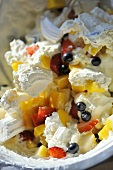 Meringue dessert with mixed fruit
