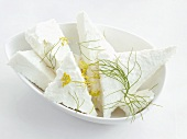 Feta cheese with dill in a small dish