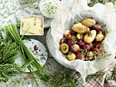 Potatoes baked in paper with butter and herb quark