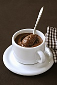 Mousse au chocolat in coffee cup with spoon