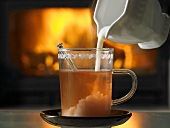 Tea with cream in front of open fire