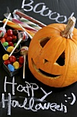 Carved pumpkin and sweets for Halloween