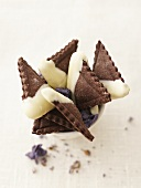 Chocolate triangles with cassis filling