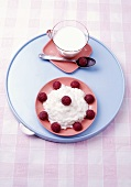 Rice pudding with raspberries and cup of milk