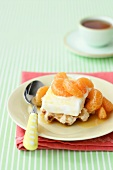 Waffles with ice cream and marinated mandarin orange segments