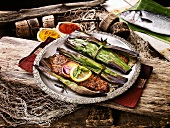 Sea bass with exotic spices grilled in banana leaves