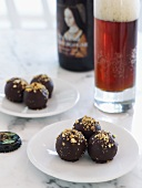 Chocolate truffles with chopped nuts