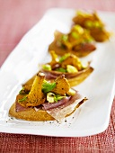 Crostini with Parma ham and chanterelles