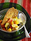 Fruit salad with almond tuille