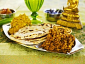 Indian lentil dish with naan bread