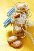 Orange chocolate biscuits in two preserving jars