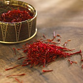 Saffron threads in and beside a small container