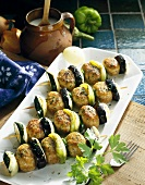 Poultry ball, aubergine and pepper kebabs