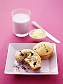Apple and raisin muffins, butter and glass of milk