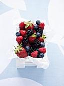 Assorted berries in wooden box