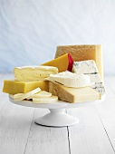 Various cheeses on cake stand