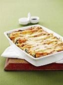 Cannelloni with ricotta and spinach filling in baking dish