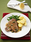 Veal steak with sage and lemon sauce, potatoes and beans
