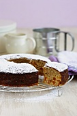 Apricot orange cake with icing sugar, a piece cut