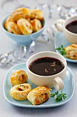 Puff pastry rolls with turkey and mint filling and a cup of borscht