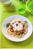 Spaghetti with chicken and vegetable sauce for children