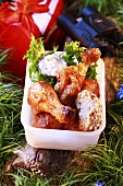 Chicken drumsticks with dip in plastic box for picnic