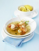 Garlic prawns in vegetable broth