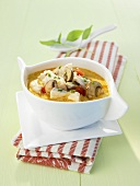 Spicy chicken stew with coconut and mushrooms