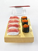 Tuna nigiri sushi and gunkan maki with salmon caviar