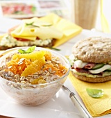 Muesli with oranges, filled roll, scrambled egg on bread