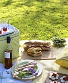 Picnic with baguette sandwiches and bean salad