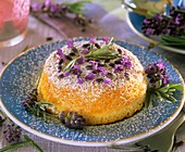 Small cake sprinkled with lavender and icing sugar