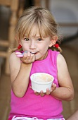 Girl eating baked beans