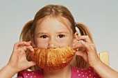 Girl eating a croissant